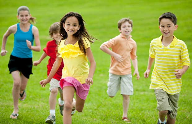 A group of diverse children playing outside.